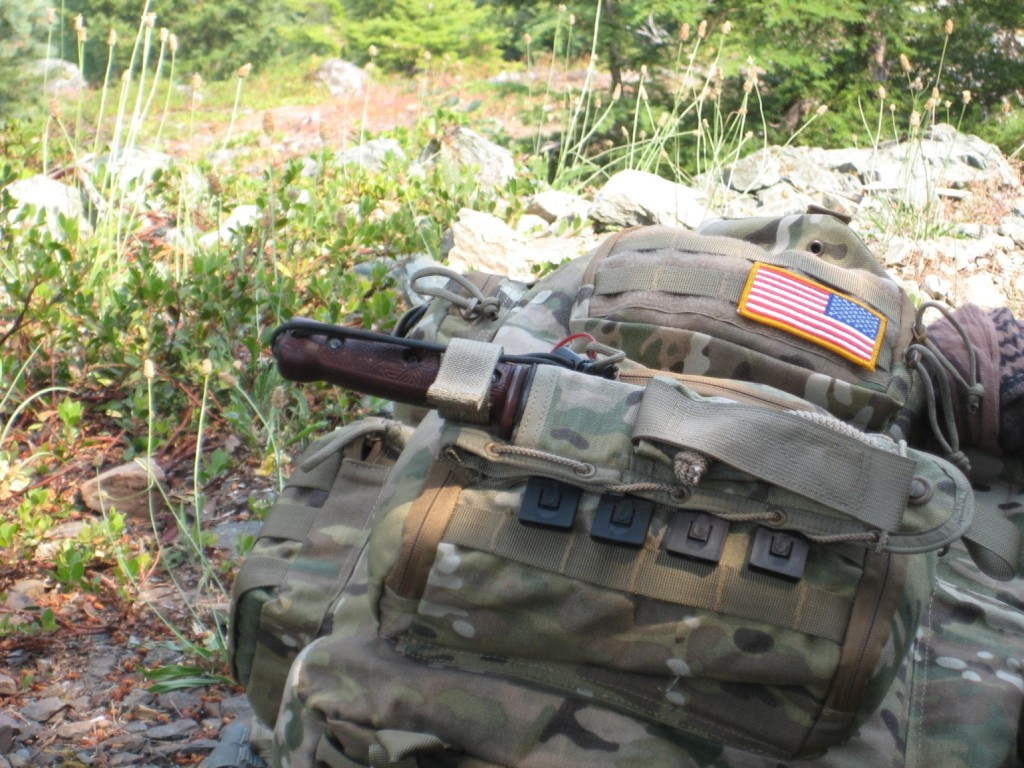 This particular knife was teamed up with a Spec Ops Brand Combat Master sheath in MultiCam Nylon- shown here attached to the owner's MultiCam pack.