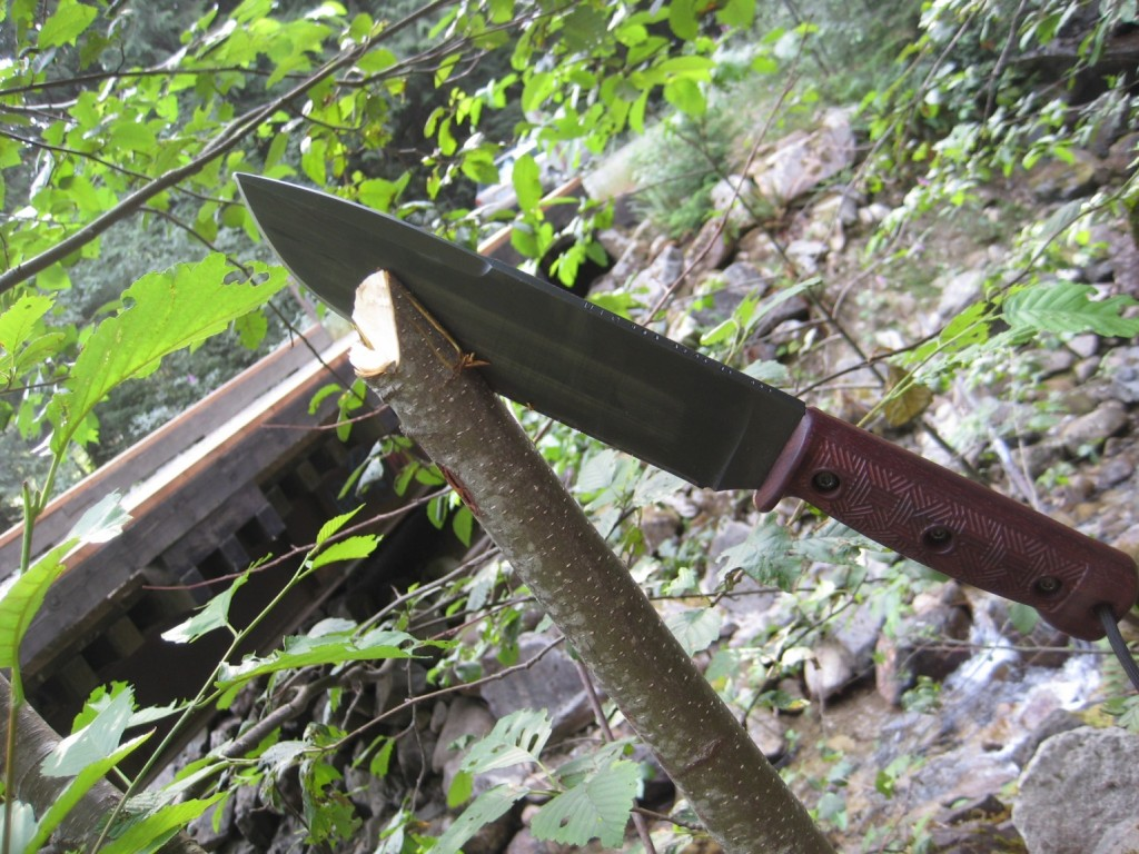 """Owner said that this picture shows the results of cutting a """"…free standing thick branch and it went right through it.""""  He added that he is """"Starting to realize it's potential.""""  If you look close you can see the markingson the top of the blade."""