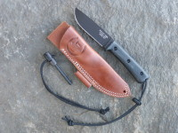 UTK0110 Black Oxide, Handle 3 in Black Micarta with Utility Tool Handi-Fire Tool and Sheath unsheathed