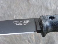 UTK0110 Black Oxide, Handle 3 in Black Micarta Ricasso Detail