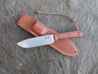 UTK0151 AS (Stonewashed finish) shown with Natural Micarta Number 3 handle and Classic leather sheath.